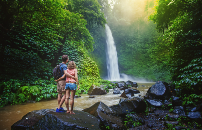 Couple looking at a waterfall in Malaysia