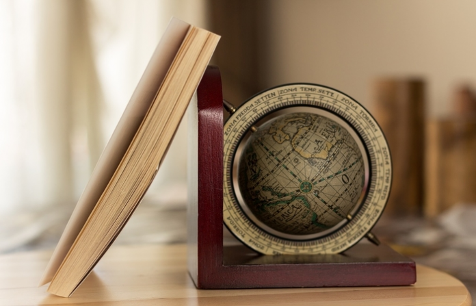 Travel book with a globe